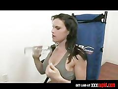 Exercising brunette rubs her clit