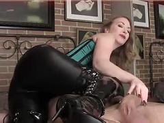 Latex boots wearing mistress enjoys teasing