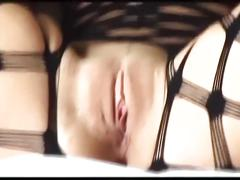 Blonde with big tits teases and masturbates in a bodystocking and stilettos