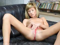 Skinny girl having a huge dildo in her pussy full