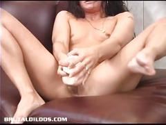 Brunette amateur cumming on a big brutal dildo