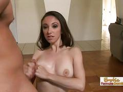 Young beautiful brunette playing with huge cock