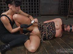 Mistress pokes her slave's pussy