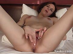 Slim redhead vixen masturbating her shaved pussy.