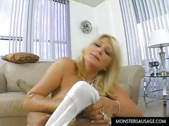 Blonde girl plays with huge cock