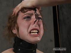 Mistress squeezes slave's tits