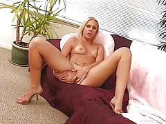 Blonde babe slides a dildo inside her