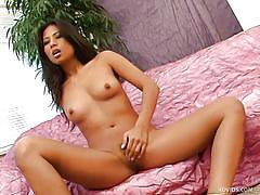 Asian pornstar shoves dildo inside her cunt