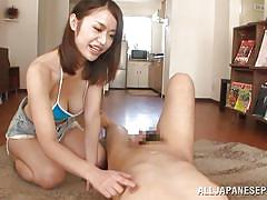 Big breasted japanese lady uses feet on her man