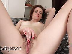 Rubbing her hairy pussy
