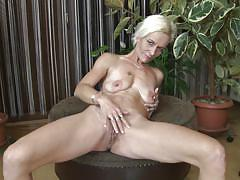 Blonde mature fingers herself