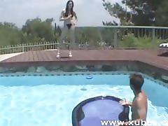 Horny brunette sucks and fuck by the poolside