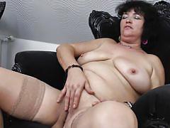 Horny brunette mature in stockings