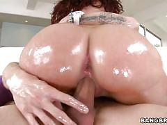 Oiled bodied babe gets a hard anal
