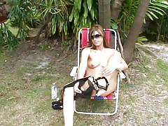 Sexy babe masturbates on lawn chair