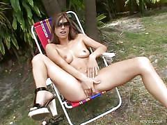 Sexy babe masturbates on lawn chair