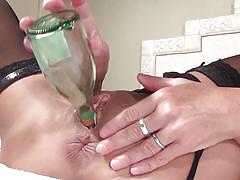 Mature fucking herself with a bottle