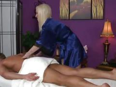 Blonde masseuse tugs then blows her client during his session