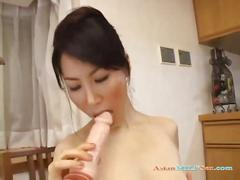Milf fucking herself with dildo having orgasm on the...