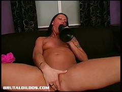How much of this giant dildo can she fit inside?