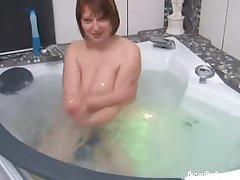 Busty babe masturbating in bathroom