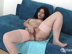 Amateur brunette belle masturbates and poses