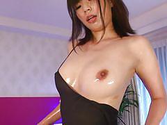 Cute japanese milf oils up her body