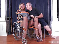 milf, blonde, bdsm, smoking, wheelchair, leather belts, mouth gagged, restraints, muzzle, infernal restraints, cherie deville