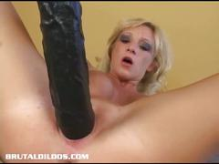 Busty slut loves her huge dildo
