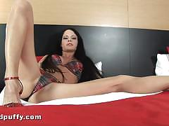 Rubbing and toying a big shaven pussy