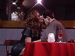 Girl rides a guy at a strip club - public