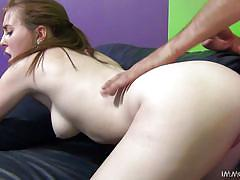 Redhead girl gets pounded from back.