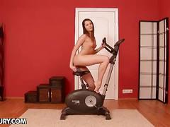 Ashley works out with a toy in her ass
