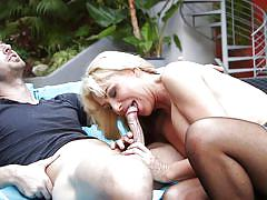 Attractive blonde sucks dick