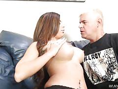 Busty brunette milf making out on couch