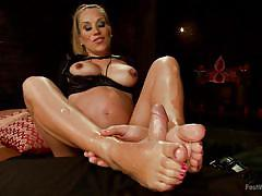 Pregnant wife giving a footjob