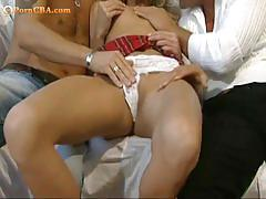 Schoolgirl blowing two cocks while getting licked