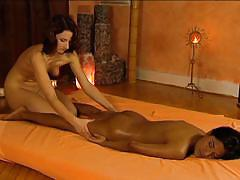 Sexy lady gives young girl a massage