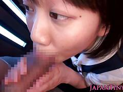 Tiny japanese girl on knees sucking an eager cock.