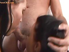 Sexy brunette babes blows one big hard cock.