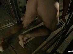 Chained gay fucked by a mysterious shemale