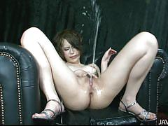 Asian babe squirts liquid from her rectum