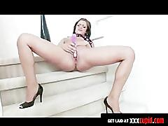 Teen plays with a sex toy on the stairs