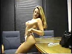 Beauitiful blonde strips in office