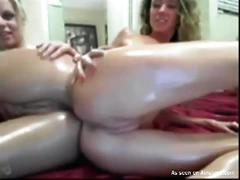 Lesbian lovers play with each other