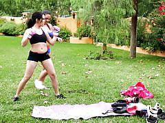 Lesbo gets a massage after a tiring workout