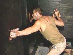 Horny studs sucking big cocks through glory holes.