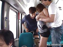 Two guys grope japanese girl on train