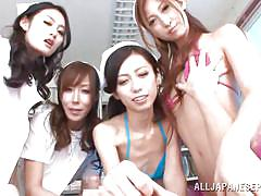 Asian nurses are playing with a patient's cock.