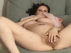 Pregnant milf displaying a big cunt